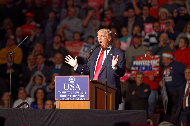 This file is licensed under the Creative Commons Attribution-Share Alike 4.0 International license. Source: https://commons.wikimedia.org/wiki/File:Donald_Trump_Victory_Tour_at_Hershey_PA_on_December_15th_2016_16.jpg